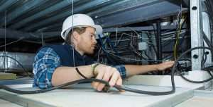 Electrician Working on Retrofit